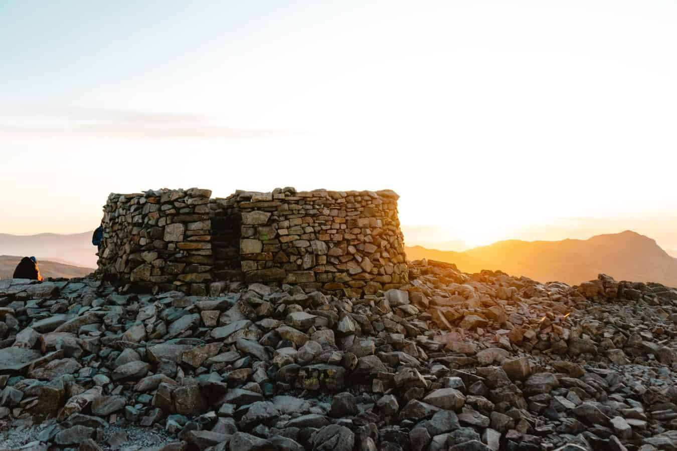 Cairn at the top of Scafell Pike in the Lake District, the highest of the 214 Wainwrights, also listed in alphabetical order