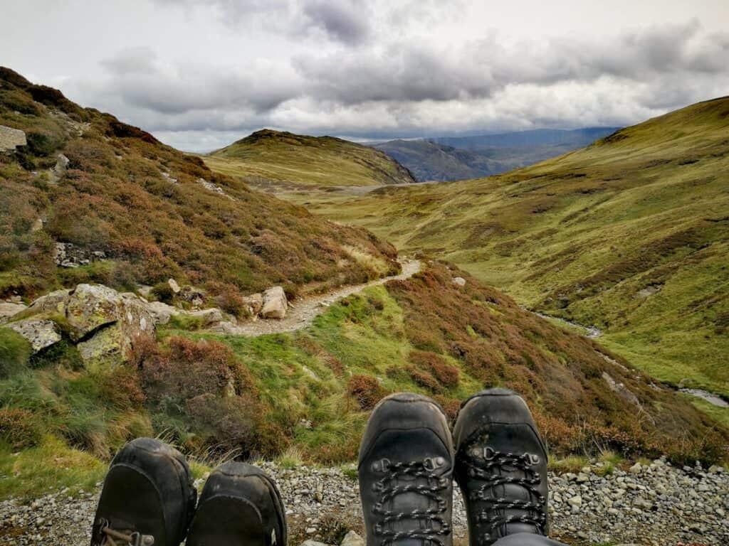 The boots of True Freedom Seekers on their way up the Wainwright in Cumbria
