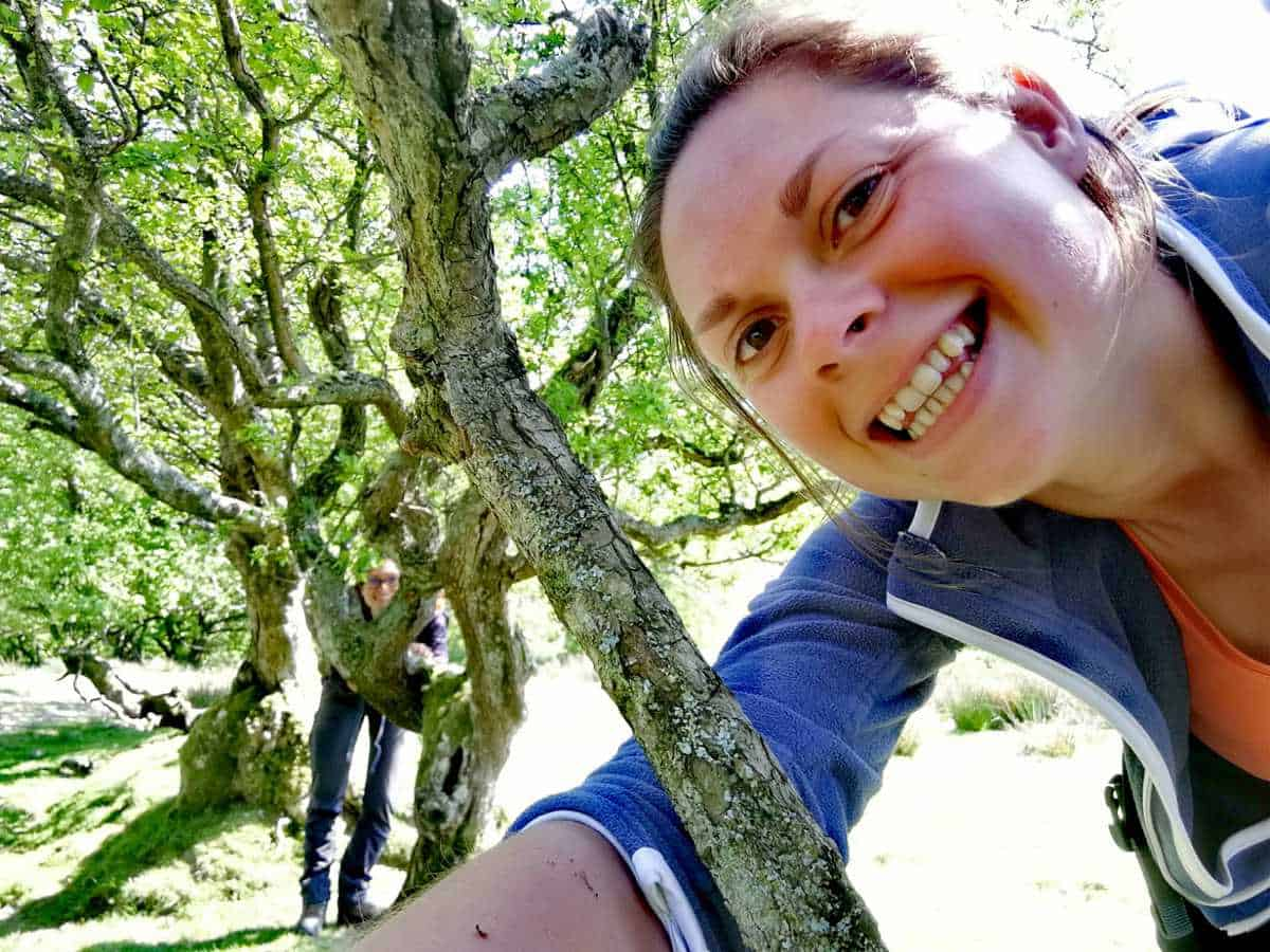 Us playing hide and seek in the trees in the Lake District