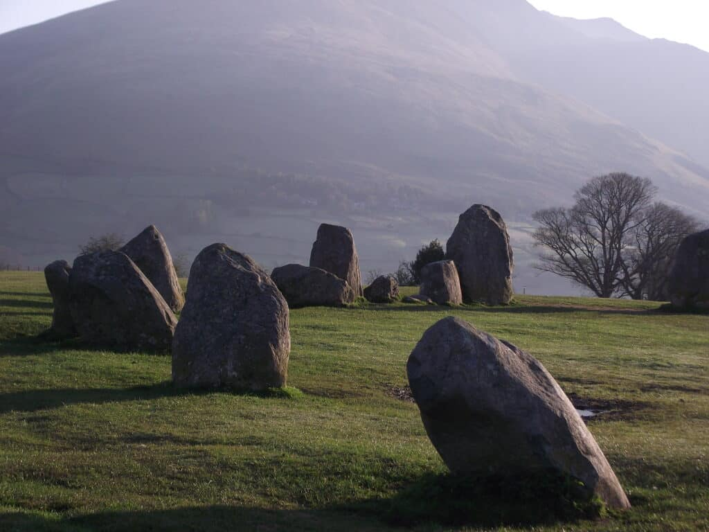 Wainwright in the background of the stone circle