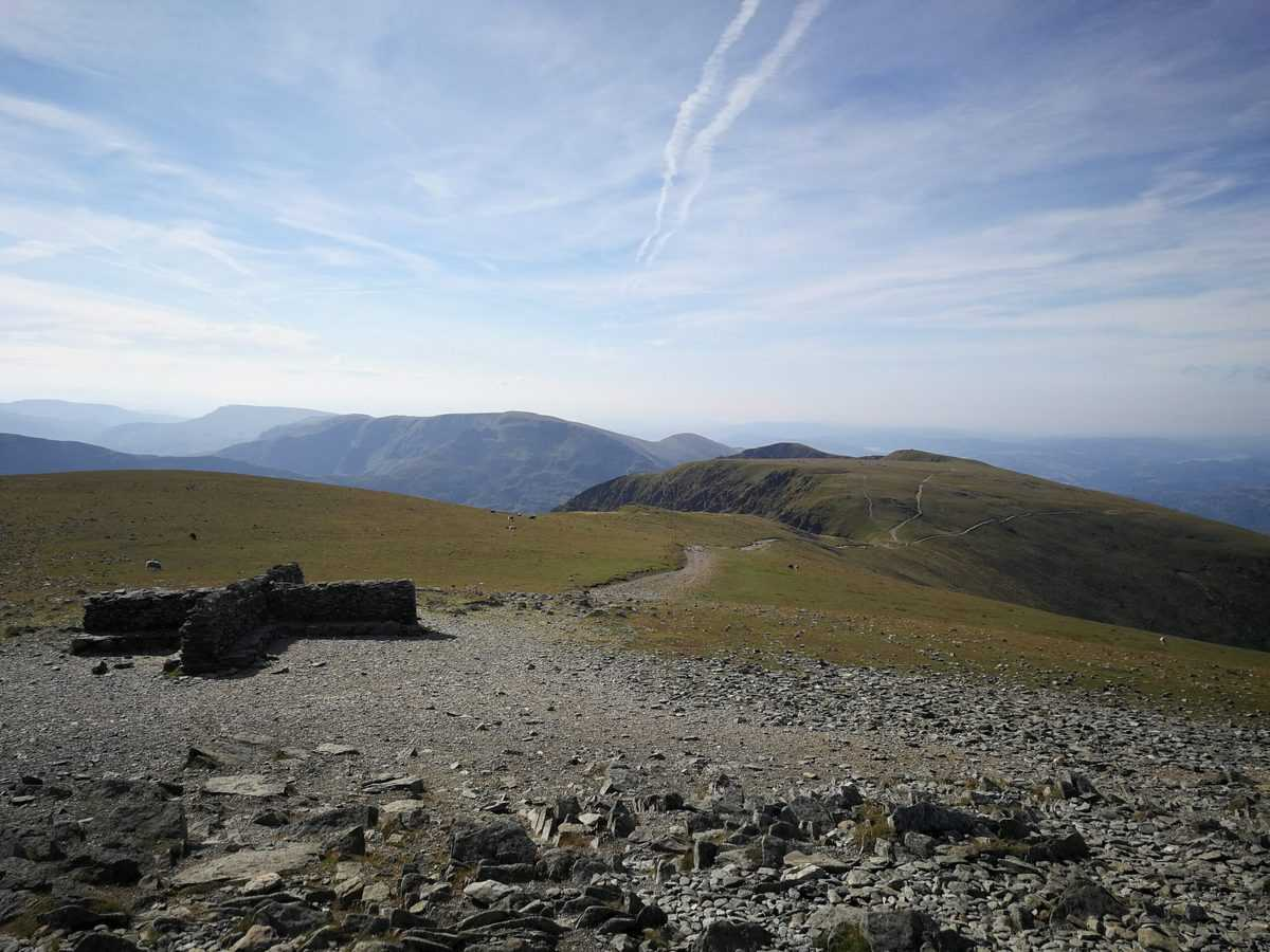Crosswind shelter at the top of Helvellyn Wainwright in the Lake District