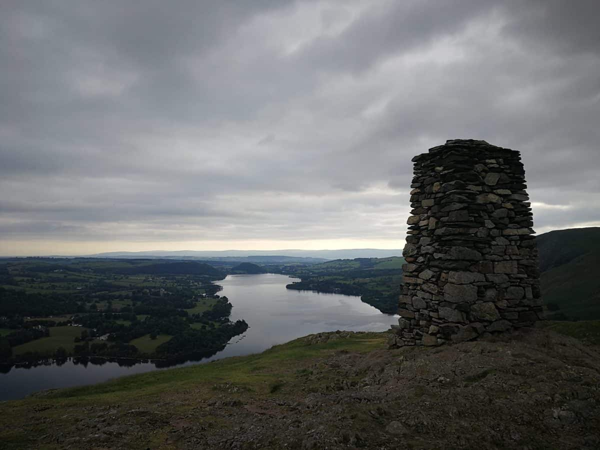 Hallin Fell huge trig point with Ullswater behind