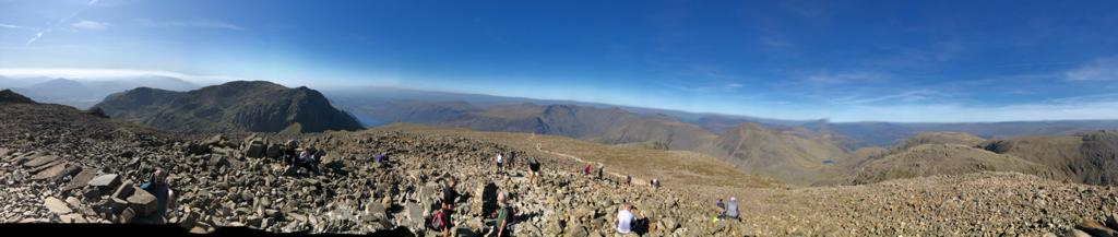 Summer on Scafell Pike (the highest mountain in England) overlooking other Wainwrights