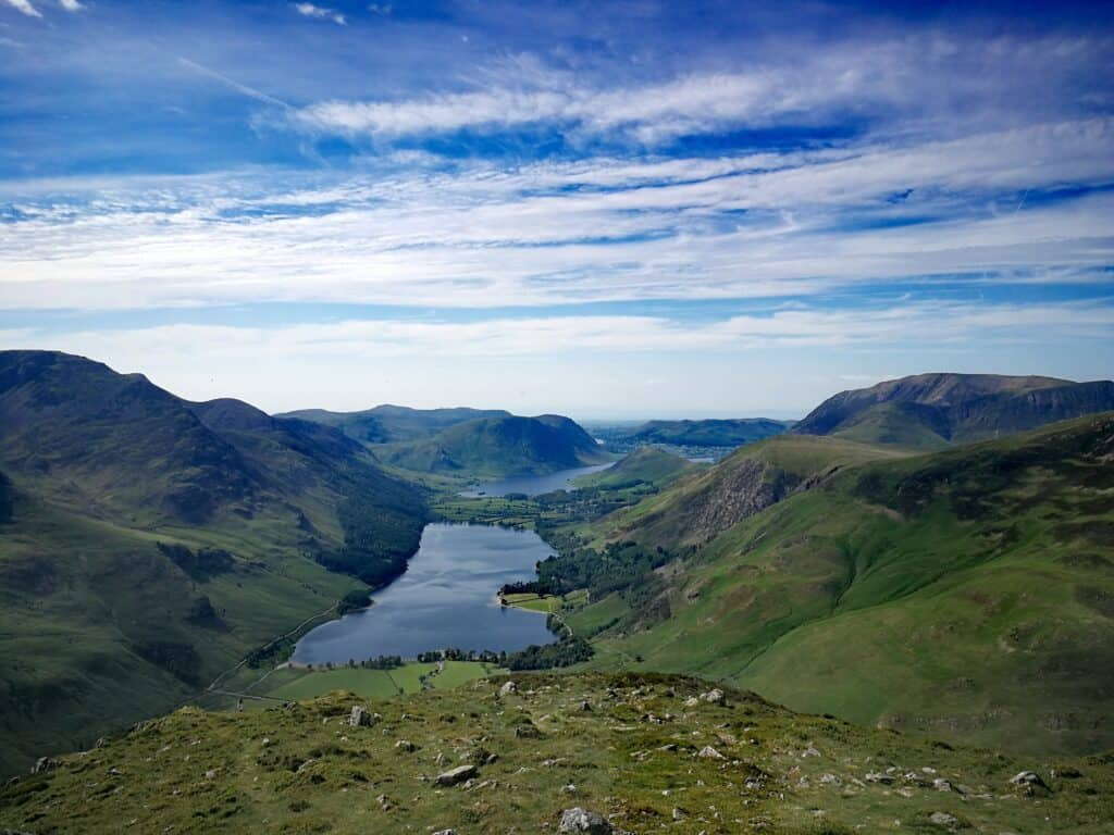 The summit of Fleetwith Pike the Wainwright in the Lake District overlooking Buttermere
