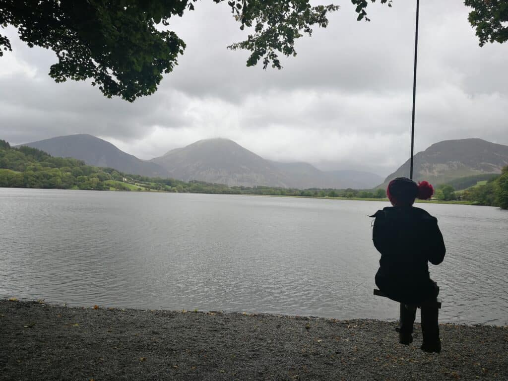 Zoe overlooking Loweswater from the swing rope