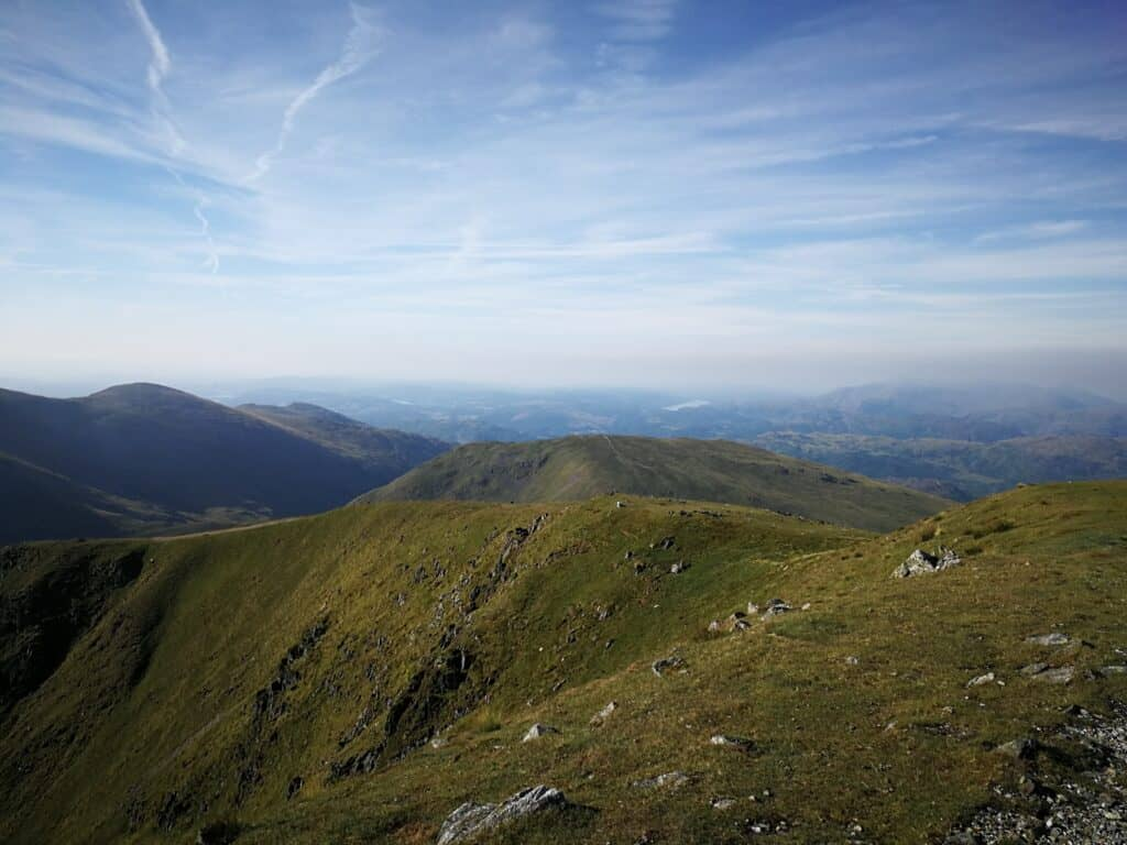 Dollywagoon Pike, and looking back across the eastern region of the Lake District