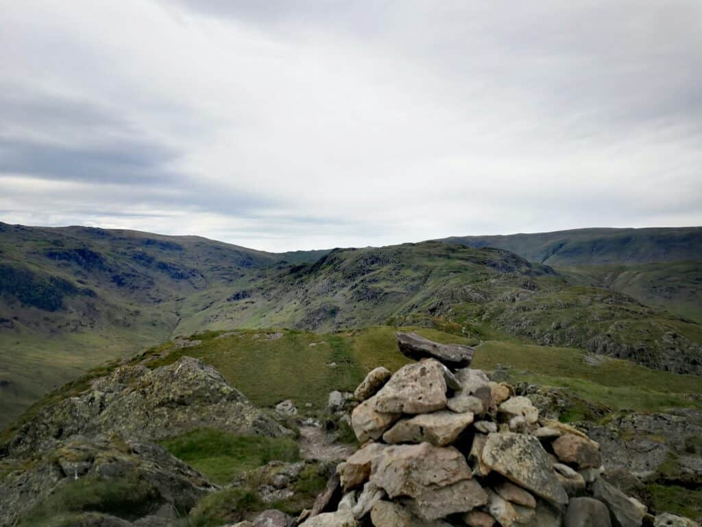Gibson Knott and the summit of the third Wainwright of the day. And going strong with our walk to Helm Crag