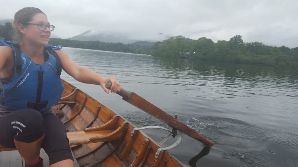 Hazel rowing on Derwent Water in our hire boat