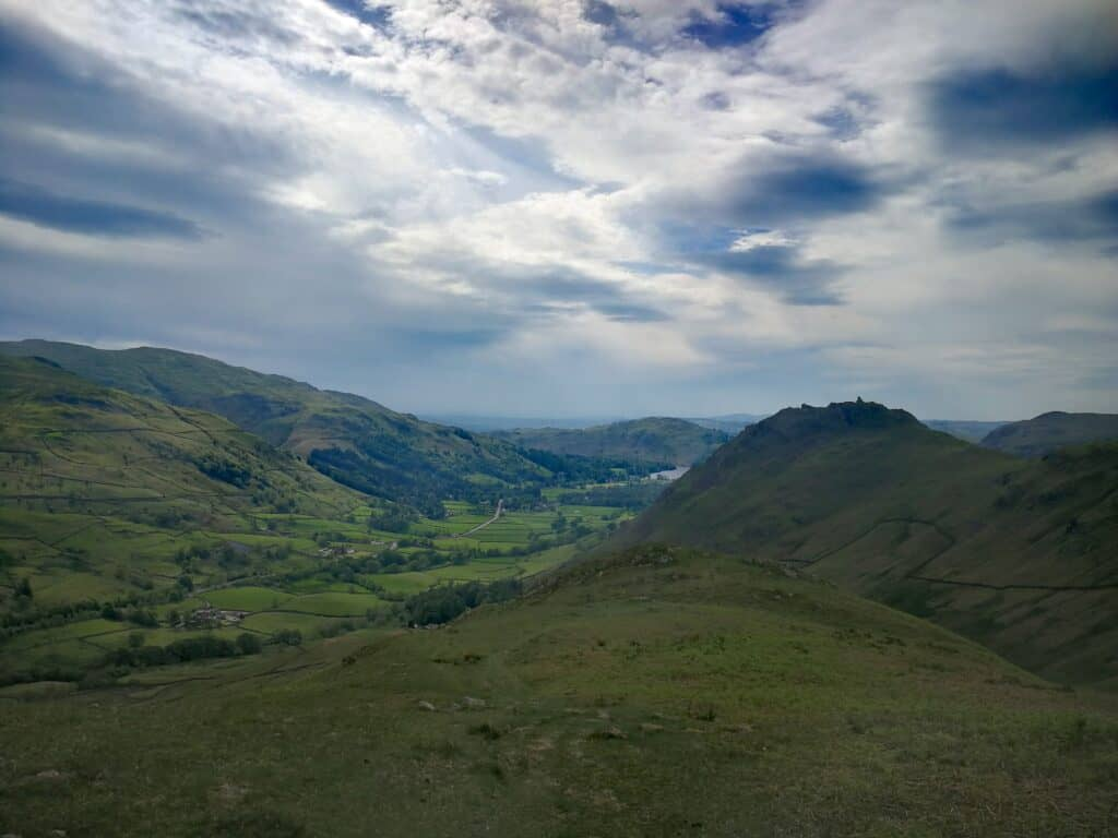On the walk up to Steel Fell in the Lake District. Looking back to Grasmere and the A591. Helm Crag to the right where we'll end our walk.