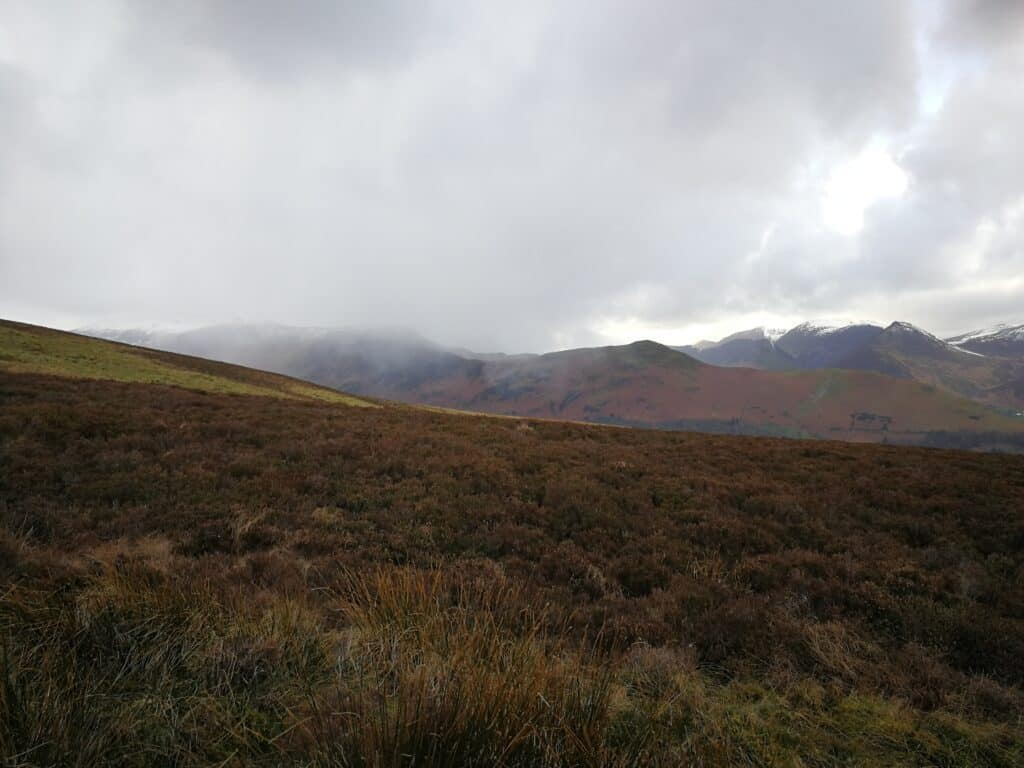 Snow clouds coming in low quick on our way up to Bleaberry Fell. Hoods and gloves at the ready.