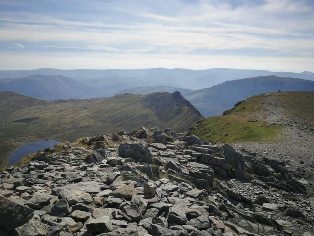 Striding Edge and Red Tarn from the summit of Helvellyn in the Lake District