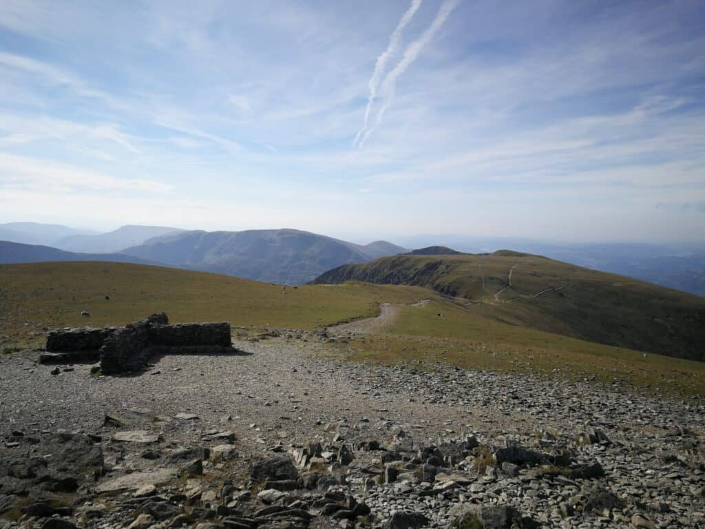 The cross shelter on Helvellyn summit, looking back towards Nethermost Pike, and the path we'll be heading down
