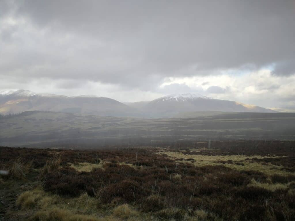 The snow shower finally hit us on our way up the Wainwright. Looking back out to Blencathra and the Skiddaw Fells