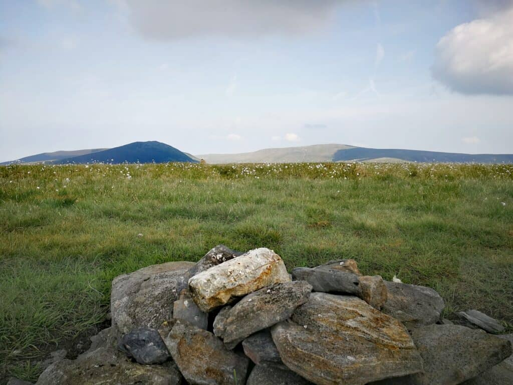 The summit cairn of Mungrisdale Common and the very flat top and the slight lack of views